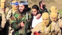 VOA60 Duniya: Mayakan ISIL Sun Kame Direban Jirgin Yakin Jordan, Siriya, Disamba 25, 2014
