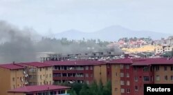 Smoke rises over Addis Ababa during protests following the fatal shooting of the Ethiopian musician Hachalu Hundessa, June 30, 2020, in this screengrab taken from a video.