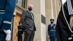 FILE - Acting U.S. Secretary of Defense Christopher Miller stands on the steps of the Pentagon entrance in Arlington, Virginia, Nov. 13, 2020.