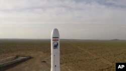 FILE - In this image taken from video, an Iranian rocket carrying a satellite is launched from an undisclosed site, believed to be in Iran's Semnan province, April 22, 2020.