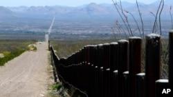 FILE - A U.S. Customs and Border Patrol truck patrols the U.S. border with Mexico in Douglas, Ariz., March 18, 2016.