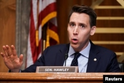 FILE - Sen. Josh Hawley, R-Mo., asks questions during a hearing in Washington, Dec. 16, 2020.