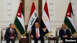 Iraqi President Barham Salih meets with King Abdullah II of Jordan and Egypt's President Abdel Fattah el-Sissi, in Baghdad, Iraq, June 27, 2021.