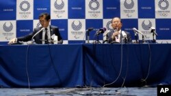 Tokyo 2020 Organizing Committee CEO Toshiro Muto, right, speaks during a news conference after a Tokyo 2020 Executive Board Meeting in Tokyo Monday, March 30, 2020. Tokyo Olympic President Yoshiro Mori said Monday he expects to talk with IOC…