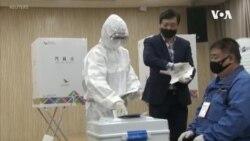 南韓舉行國會選舉 選民戴口罩及塑膠手套投票