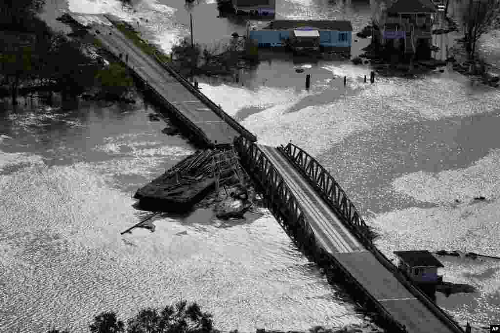 A barge damages a bridge that divides Lafitte, Louisiana, and Jean Lafitte, Louisiana, in the aftermath of Hurricane Ida, Aug. 30, 2021, in Lafitte.