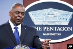 FILE - Defense Secretary Lloyd Austin speaks during a briefing at the Pentagon in Washington, May 6, 2021.
