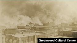 Black Wall Street burns in Tulsa, Oklahoma, June 1921. (Courtesy Greenwood Cultural Center)