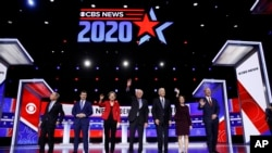 From left, Democratic presidential candidates, Mike Bloomberg, Pete Buttigieg, Sen. Elizabeth Warren, Sen. Bernie Sanders, former Vice President Joe Biden, Sen. Amy Klobuchar, and Tom Styer.