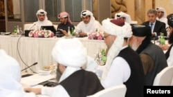 Undated handout picture of U.S., Taliban and Qatar officials during a meeting for peace talks in Doha, Qatar. Qatari Foreign Ministry/Handout via REUTERS ATTENTION EDITORS - THIS PICTURE WAS PROVIDED BY A THIRD PARTY.