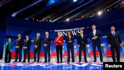 FILE - Democratic U.S. presidential candidates before the start at the 2020 Democratic U.S. presidential debate in Houston, Sept. 12, 2019.