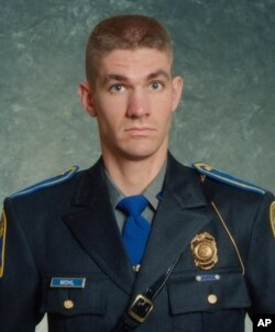 This undated photo provided by the Connecticut State Police shows Sgt. Brian Mohl, a 26-year veteran of their Woodbury department. Mohl called for help about 3:30 a.m., Sept. 2, 2021.