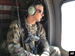FILE - U.S. Army Lt. Gen. Stephen Townsend watches during a tour north of Baghdad, Iraq, Feb. 8, 2017.