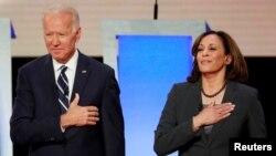 FILE - Former Vice President Joe Biden and U.S. Senator Kamala Harris take the stage before the start of the second night of the second U.S. 2020 presidential Democratic candidates debate in Detroit, Michigan, U.S., July 31, 2019.