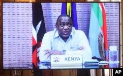 FILE - Kenyan President Uhuru Kenyatta appears on a screen as he speaks during a virtual bilateral meeting with Secretary of State Antony Blinken at the State Department in Washington, April 27, 2021.
