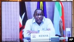 Kenyan President Uhuru Kenyatta appears on a screen as he speaks during a virtual bilateral meeting with Secretary of State Antony Blinken at the State Department in Washington, April 27, 2021.