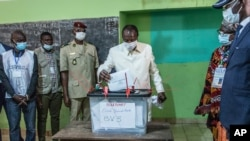 Guinean President Alpha Conde casts his ballot in Conakry, Guinea, Oct. 18, 2020.