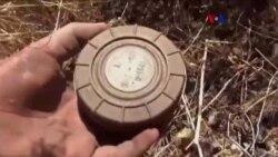 Voluntarios desmantelan minas en Siria