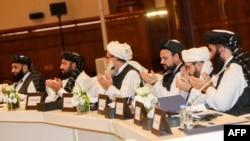Taliban müzakirəçiləri Dohada danışıqlar zamanı, 8 iyul, 2019.