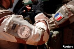 FILE - A close-up of France's Operation Barkhane patch worn by French troops in Africa's Sahel region, in Inaloglog, Mali, October 17, 2017.