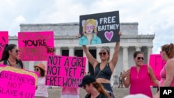 Fans and supporters of pop star Britney Spears protest at the Lincoln Memorial, during a 'Free Britney' rally, July 14, 2021, in Washington.