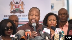 FILE - Kenya's Health Minister Mutahi Kagwe (C) speaks at Mbagathi Hospital during the launch of an isolation and treatment center for coronavirus patients, in Nairobi, Kenya, March 6, 2020.