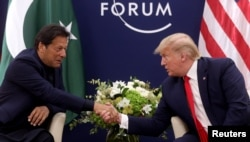 President Donald Trump shakes hands with Pakistan's Prime Minister Imran Khan during a bilateral meeting at the 50th World Economic Forum annual meeting in Davos, Switzerland, Jan. 21, 2020.