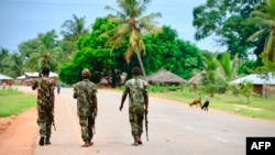 (FILES) In this file photo taken on March 07, 2018 Soldiers from the Mozambican army patrol the streets after security in the area was increased, following a two-day attack from suspected islamists in October last year in Mocimboa da Praia,…