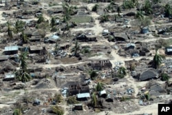 FILE - An aerial shot shows widespread destruction caused by Cyclone Kenneth when it struck Ibo island north of Pemba city in Mozambique, May, 1, 2019.