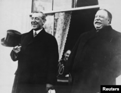 FILE - President-elect Woodrow Wilson and President William Howard Taft laugh on the White House steps before departing together for Wilson's inauguration in Washington, D.C., U.S. in March 1913.