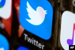 FILE - The Twitter icon is shown on a mobile phone.