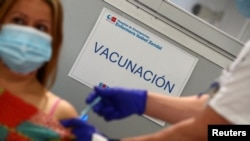 """A sign reading """"Vaccination"""" is pictured as Spain resumes vaccination with AstraZeneca shots, amid the coronavirus outbreak, at Enfermera Isabel Zendal hospital in Madrid, Spain, March 24, 2021."""