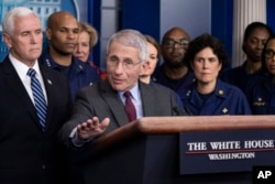 Dr. Anthony Fauci, director of the National Institute of Allergy and Infectious Diseases, with Vice President Mike Pence behind him, speaks during a briefing about the coronavirus in the James Brady Press Briefing Room of the White House, March 15, 2020,