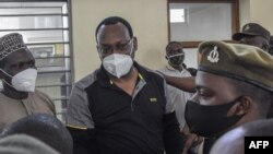 FILE - Tanzania Chadema party chairman Freeman Mbowe stand in the dock at Kisutu Resident Magistrate's Court in Dar es Salaam on Aug, 06, 2021.