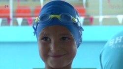 Cậu bé cụt tay đoạt huy chương vàng bơi lội