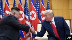 "FILE - U.S. President Donald Trump and North Korean leader Kim Jong Un meet in the Demilitarized Zone, South Korea, June 30, 2019. North Korea on Friday says it wants Trump to make a ""wise option and bold decision"" to restart stalled nuclear diplomacy"