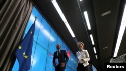 European Council President Charles Michel and European Commission President Ursula von der Leyen leave following a virtual summit with Chinese President Xi Jinping in Brussels, Belgium June 22, 2020.
