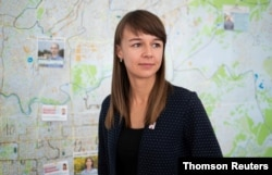 Municipal candidate and Alexei Navalny ally Ksenia Fadeeva poses for a portrait in a local campaign office in Tomsk, Russia, Sept. 12, 2020.