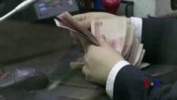 人民币国际化势头虽猛 取代美元地位尚需时日