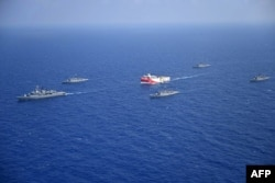 FILE - A handout photo released by the Turkish Defense Ministry Aug. 12, 2020, shows Turkish seismic research vessel Oruc Reis (C) as it is escorted by Turkish Naval ships in the Mediterranean Sea, off Antalya, Aug. 10, 2020.