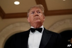 President Donald Trump stands in front of the media while talking about the situation at the U.S. embassy in Baghdad, from his Mar-a-Lago property, Dec. 31, 2019, in Palm Beach, Fla.