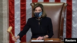 U.S. House Speaker Nancy Pelosi, D-Calif., presides over the vote to impeach President Donald Trump for a second time, a week after his supporters stormed the Capitol building, on the floor of the House of Representatives in Washington, Jan. 13, 2021.