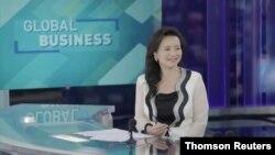 Водителка во глобалната кинеска телевизиска мрежа во сопственост на официјален Пекинг