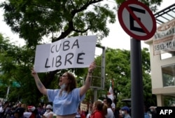 Cuban citizens take part in a demonstration against Cuban President Miguel Diaz-Canel's government outside the Cuban Embassy, in Mexico City on July 12, 2021.