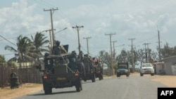 A military convoy of South Africa National Defense Forces patrols in Pemba, Aug. 5, 2021. The Southern African Development Community bloc is rallying behind neighboring Mozambique, sending troops to battle jihadists wreaking havoc in the north.