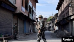 ndian security forces personnel stand guard in front of closed shops during restrictions imposed by authorities following the death of Syed Ali Shah Geelani, a Kashmiri veteran separatist politician, in Srinagar Sept. 3, 2021.