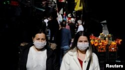 People wear protective face masks due to coronavirus concerns in Istanbul, Turkey March 13, 2020.