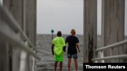 Way Williams, 65, and his wife Jennifer, 60, hold hands at Bay Vista Park, as Elsa briefly strengthened into a Category 1 hurricane hours before an expected landfall on Florida's northern Gulf Coast, in St. Petersburg, Florida, July 6, 2021.