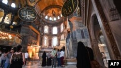 Tourists visit the inside of Hagia Sophia on July 10, 2020, in Istanbul, before a top Turkish court revoked the sixth-century Hagia Sophia's status as a museum, clearing the way for it to be turned back into a mosque. - The Council of State, the…
