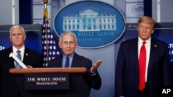FILE - President Donald Trump and Vice President Mike Pence listen as Dr. Anthony Fauci, director of the National Institute of Allergy and Infectious Diseases, speaks about the coronavirus in the James Brady Press Briefing Room of the White House in Washi